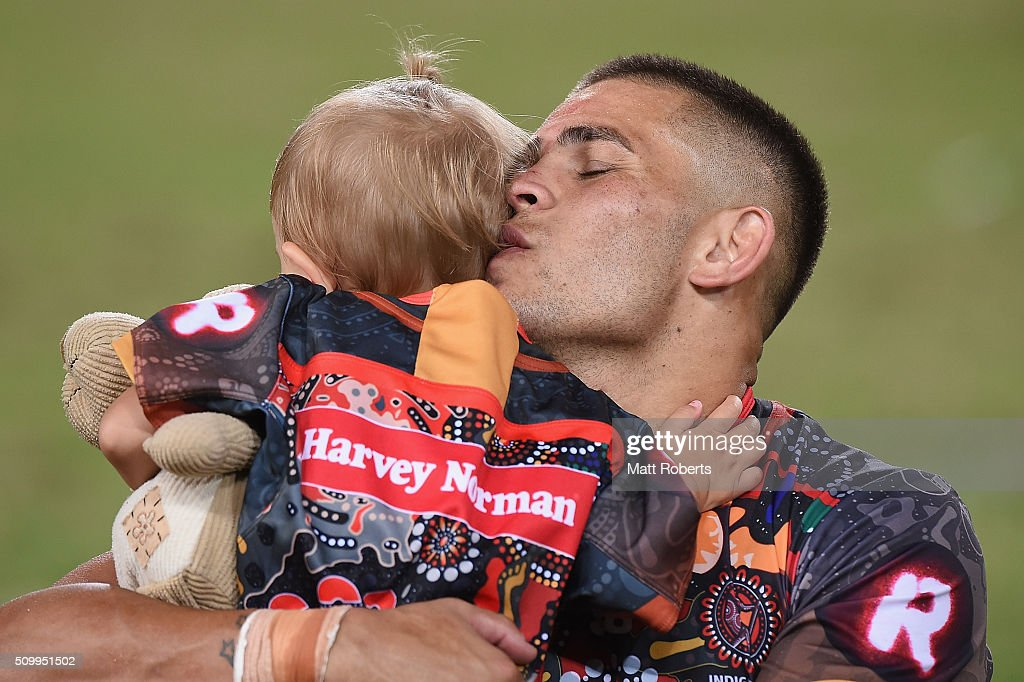 Craig Garvey of the Indigenous All Stars kisses is daughter after the NRL match between the Indigenous All-Stars and the World All-Stars at Suncorp Stadium on February 13, 2016 in Brisbane, Australia.