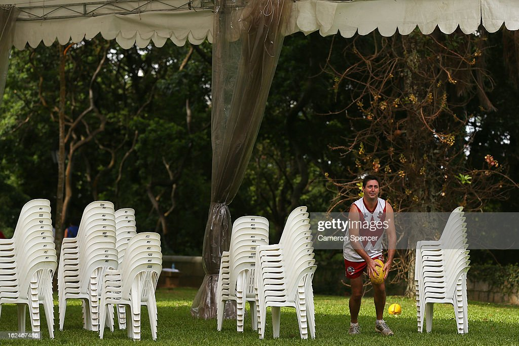 Craig Geehman of the Wombats avoids some chairs and kicks during a Singapore Wombats Aussie Rules training session at Fort Canning Park on February 23, 2013 in Singapore. The Singapore Australian Football Club (SAFC), known as the Singapore Wombats is celebrating 20 years this year. Established by Australian expatriates in 1993, the amateur team plays clubs from Indonesia, Japan, the Philippines, Thailand and Vietnam in an Asian Championship.