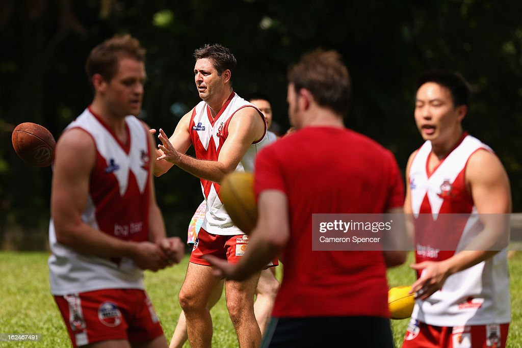 Craig Geehman of the Wombats catches the ball during a Singapore Wombats Aussie Rules training session at Fort Canning Park on February 23, 2013 in Singapore. The Singapore Australian Football Club (SAFC), known as the Singapore Wombats is celebrating 20 years this year. Established by Australian expatriates in 1993, the amateur team plays clubs from Indonesia, Japan, the Philippines, Thailand and Vietnam in an Asian Championship.