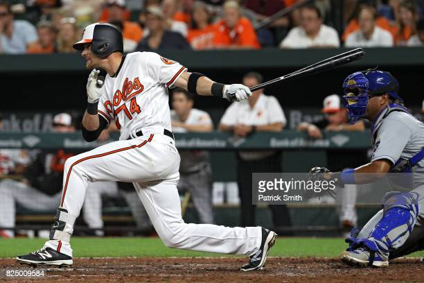 Craig Gentry of the Baltimore Orioles hits a walkoff RBI single during the ninth inning against the Kansas City Royals at Oriole Park at Camden Yards...