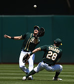 Craig Gentry of the Oakland Athletics avoids colliding with Eric Sogard while catching a fly ball off the bat of Alexei Ramirez of the Chicago White...