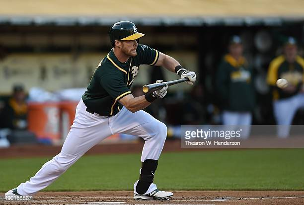 Craig Gentry of the Oakland Athletics bunts for a base hit in the bottom of the first inning against the Chicago White Sox at Oco Coliseum on May 12...