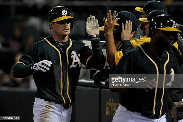 Craig Gentry of the Oakland Athletics celebrates after scoring in the third inning of their game against the Oakland Athletics at Oco Coliseum on...