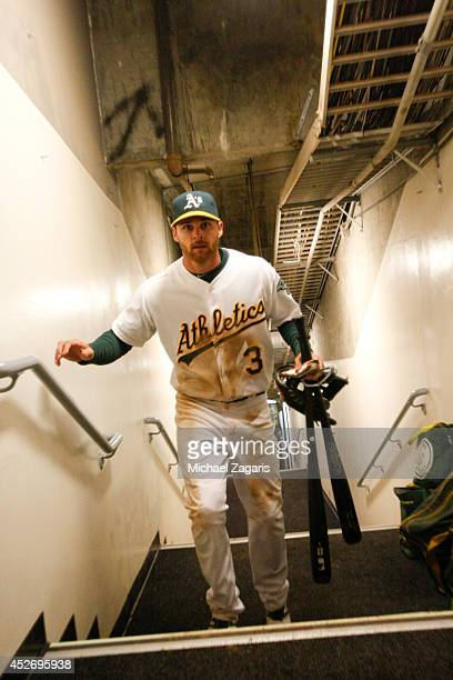 Craig Gentry of the Oakland Athletics heads to the clubhouse following the game against the San Francisco Giants at Oco Coliseum on July 7 2014 in...