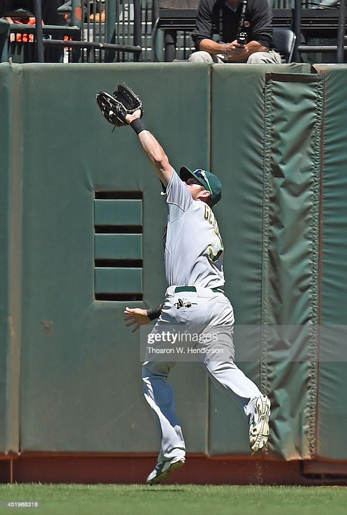 <a gi-track='captionPersonalityLinkClicked' href=/galleries/search?phrase=Craig+Gentry&family=editorial&specificpeople=6352553 ng-click='$event.stopPropagation()'>Craig Gentry</a> #3 of the Oakland Athletics runs back to the warning track to take a hit away from Tim Hudson #17 of the San Francisco Giants in the bottom of the fifth inning at AT&T Park on July 10, 2014 in San Francisco, California.