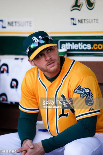 Craig Gentry of the Oakland Athletics sits in the dugout prior to the game against the Seattle Mariners at Oco Coliseum on May 5 2014 in Oakland...