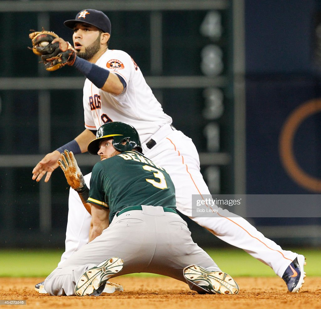 Craig Gentry of the Oakland Athletics steals second base in the ninth inning as Marwin Gonzalez of the Houston Astros is late on the tag at Minute...