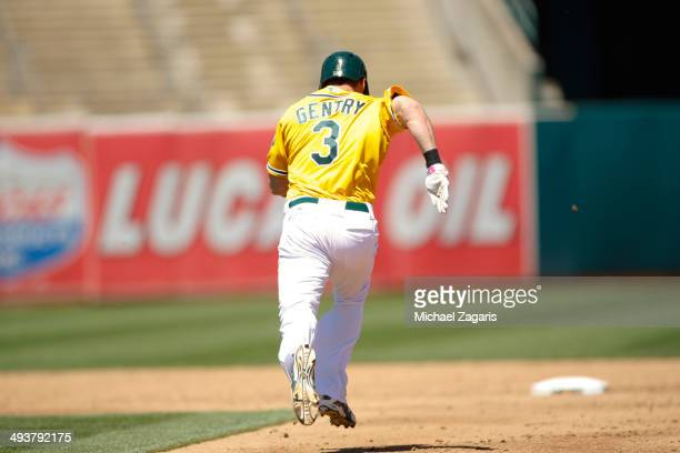 Craig Gentry of the Oakland Athletics steals second during the game against the Washington Nationals at Oco Coliseum on May 11 2014 in Oakland...