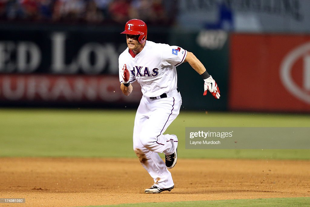 Craig Gentry #23 of the Texas Rangers advances to third base against the New York Yankees on July 24, 2013 at the Rangers Ballpark in Arlington in Arlington, Texas.
