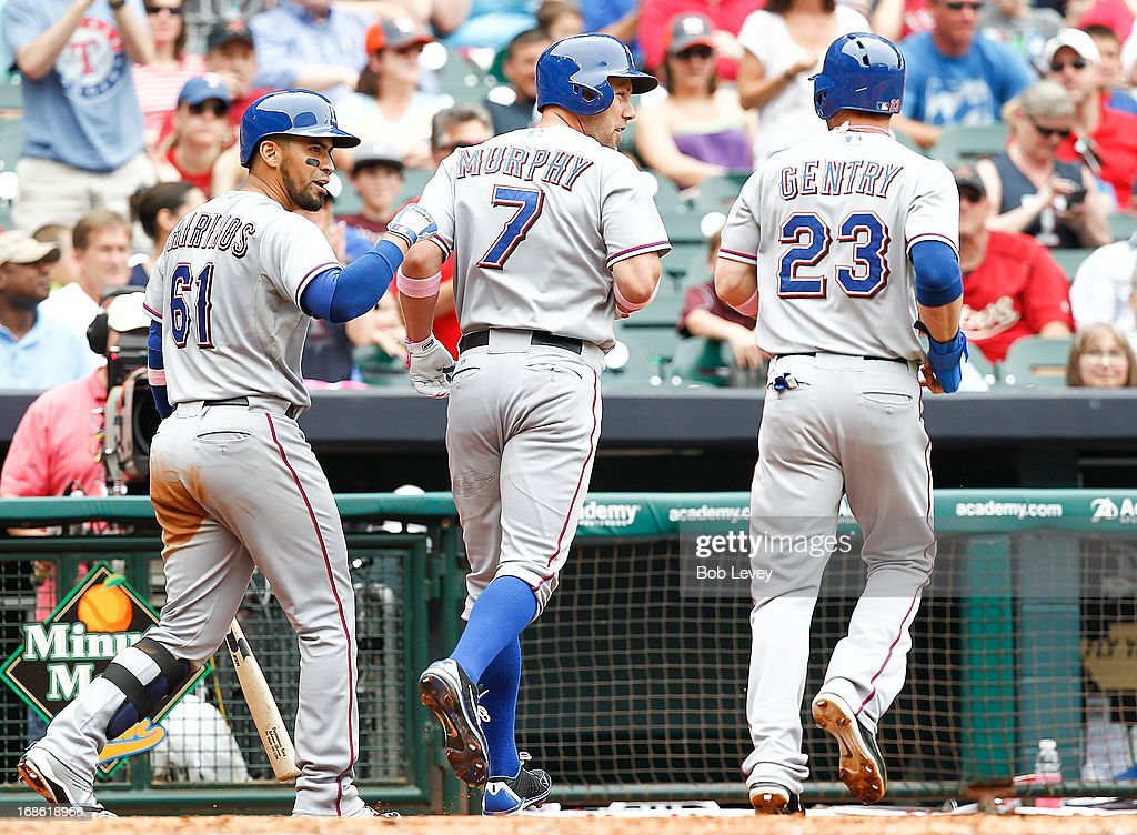 <a gi-track='captionPersonalityLinkClicked' href=/galleries/search?phrase=Craig+Gentry&family=editorial&specificpeople=6352553 ng-click='$event.stopPropagation()'>Craig Gentry</a> #23 of the Texas Rangers and Robinson Chirinos #61 congratulate David Murphy #7 of the Texas Rangers after Murphy hit a home run against the Houston Astros in the third inning at Minute Maid Park on May 12, 2013 in Houston, Texas.