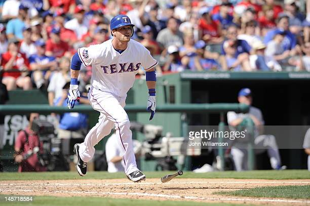 Craig Gentry of the Texas Rangers bats and runs to first base from the batter's box in the game against the Toronto Blue Jays at Rangers Ballpark on...