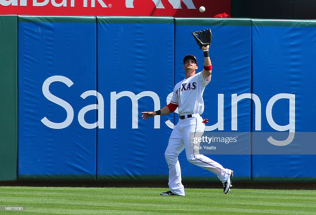 <a gi-track='captionPersonalityLinkClicked' href=/galleries/search?phrase=Craig+Gentry&family=editorial&specificpeople=6352553 ng-click='$event.stopPropagation()'>Craig Gentry</a> #23 of the Texas Rangers catches a fly ball hit by Howard Kendrick #47 of the Los Angeles Angels of Anaheim in the eighth inning at Rangers Ballpark in Arlington on April 5, 2013 in Arlington, Texas.