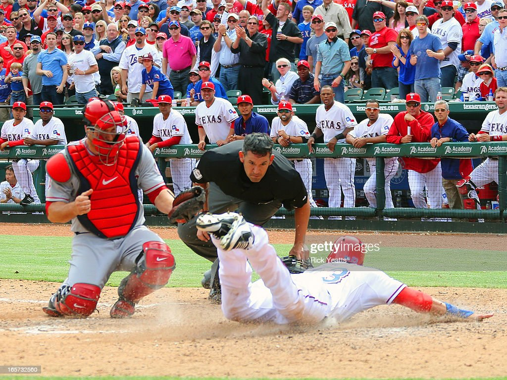 <a gi-track='captionPersonalityLinkClicked' href=/galleries/search?phrase=Craig+Gentry&family=editorial&specificpeople=6352553 ng-click='$event.stopPropagation()'>Craig Gentry</a> #23 of the Texas Rangers dives and scores beating the tag against <a gi-track='captionPersonalityLinkClicked' href=/galleries/search?phrase=Chris+Iannetta&family=editorial&specificpeople=836137 ng-click='$event.stopPropagation()'>Chris Iannetta</a> #17 of the Los Angeles Angels of Anaheim on a hit by at Rangers Ballpark on April 5, 2013 in Arlington, Texas.