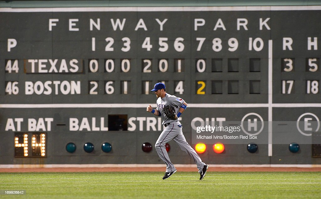<a gi-track='captionPersonalityLinkClicked' href=/galleries/search?phrase=Craig+Gentry&family=editorial&specificpeople=6352553 ng-click='$event.stopPropagation()'>Craig Gentry</a> #23 of the Texas Rangers heads to the dugout with the Boston Red Sox leading 17-3 at the end of the seventh inning on June 4, 2013 at Fenway Park in Boston, Massachusetts.