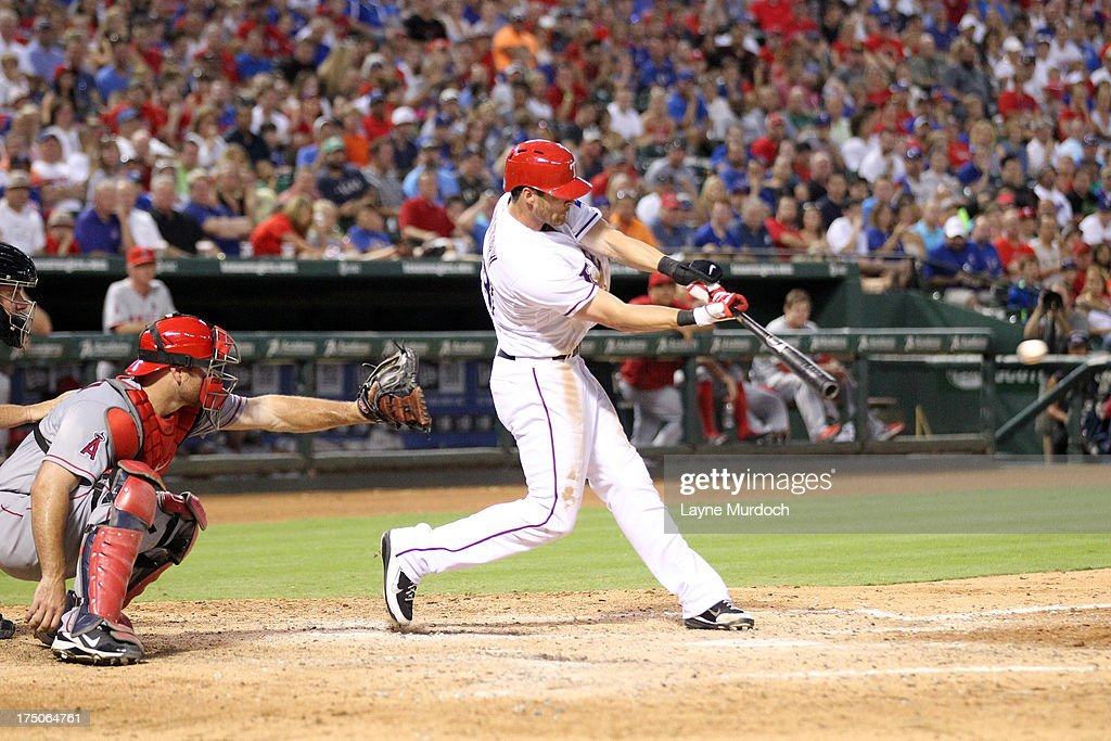 <a gi-track='captionPersonalityLinkClicked' href=/galleries/search?phrase=Craig+Gentry&family=editorial&specificpeople=6352553 ng-click='$event.stopPropagation()'>Craig Gentry</a> #23 of the Texas Rangers hits a 2-run single against the Los Angeles Angels of Anaheim on July 30, 2013 at the Rangers Ballpark in Arlington in Arlington, Texas.