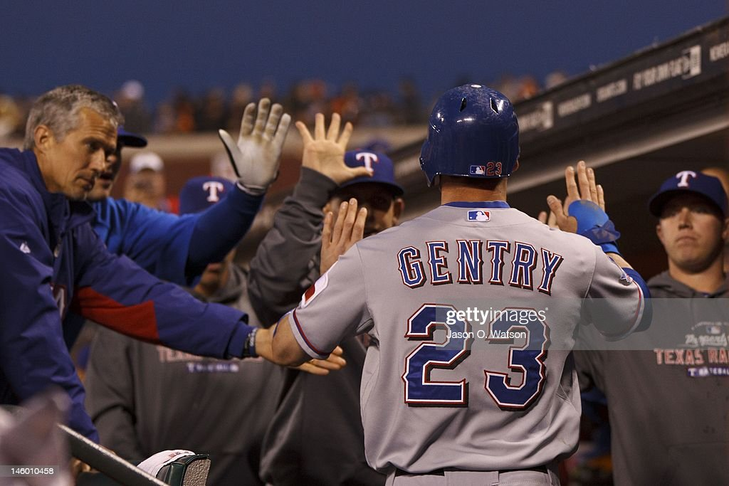 <a gi-track='captionPersonalityLinkClicked' href=/galleries/search?phrase=Craig+Gentry&family=editorial&specificpeople=6352553 ng-click='$event.stopPropagation()'>Craig Gentry</a> #23 of the Texas Rangers is congratulated by teammates in the dugout after scoring a run against the San Francisco Giants during the sixth inning of an interleague game at AT&T Park on June 8, 2012 in San Francisco, California.