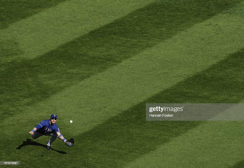 Craig Gentry #23 of the Texas Rangers makes a catch in center field during the sixth inning of the game against the Minnesota Twins on April 27, 2013 at Target Field in Minneapolis, Minnesota. The Twins defeated the Rangers 7-2.