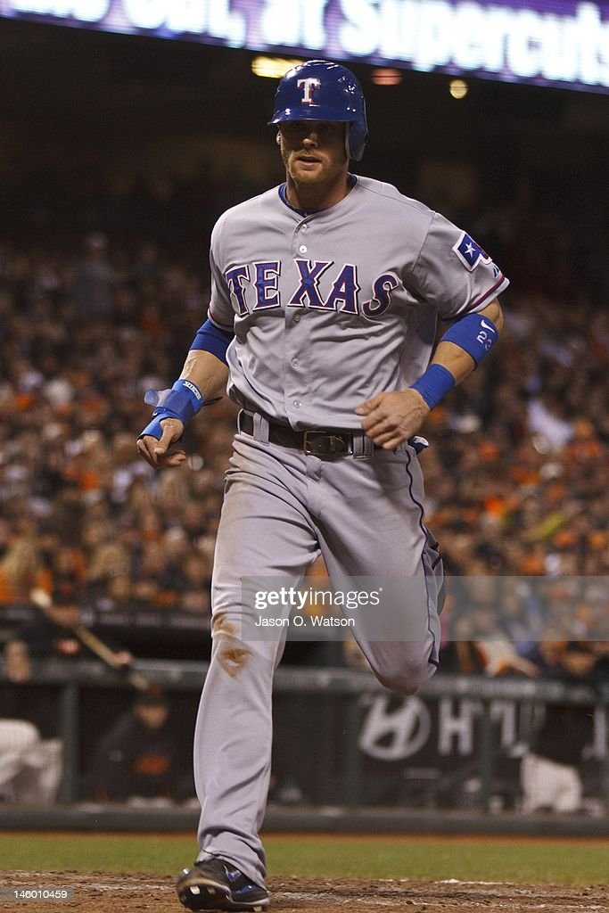 <a gi-track='captionPersonalityLinkClicked' href=/galleries/search?phrase=Craig+Gentry&family=editorial&specificpeople=6352553 ng-click='$event.stopPropagation()'>Craig Gentry</a> #23 of the Texas Rangers scores a run against the San Francisco Giants during the sixth inning of an interleague game at AT&T Park on June 8, 2012 in San Francisco, California.