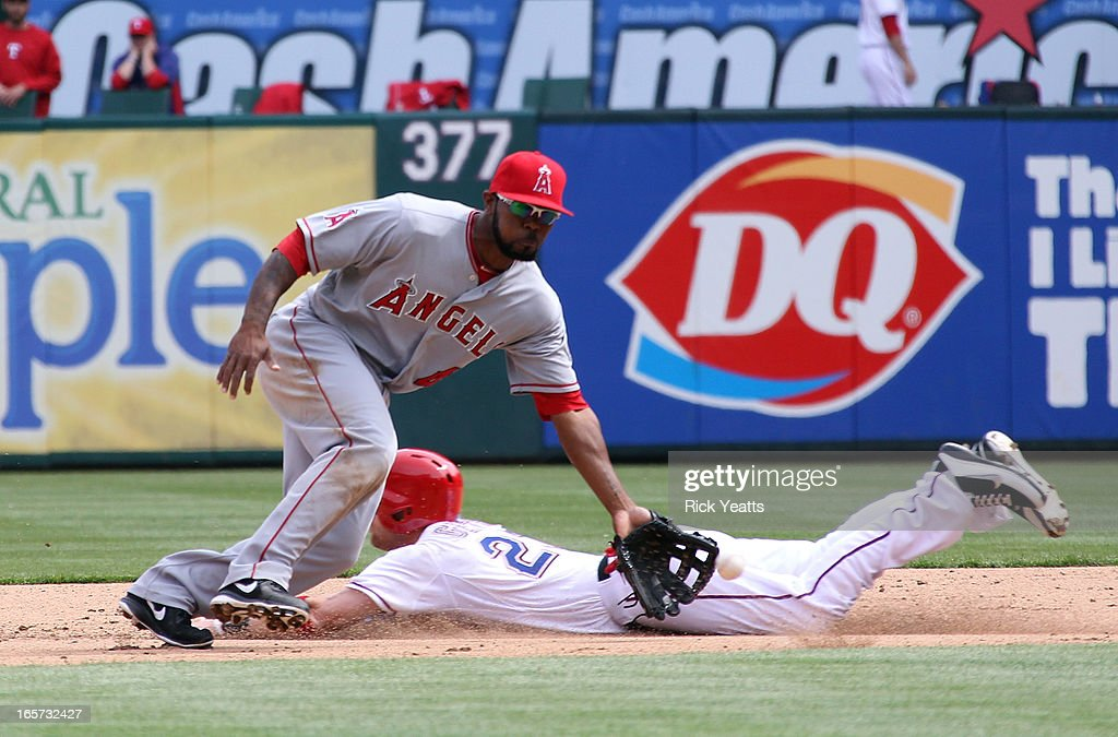 <a gi-track='captionPersonalityLinkClicked' href=/galleries/search?phrase=Craig+Gentry&family=editorial&specificpeople=6352553 ng-click='$event.stopPropagation()'>Craig Gentry</a> #23 of the Texas Rangers slides and beats the tag at second base against Howard Kendrick #47 of the Los Angeles Angels of Anaheim at Rangers Ballpark on April 5, 2013 in Arlington, Texas.