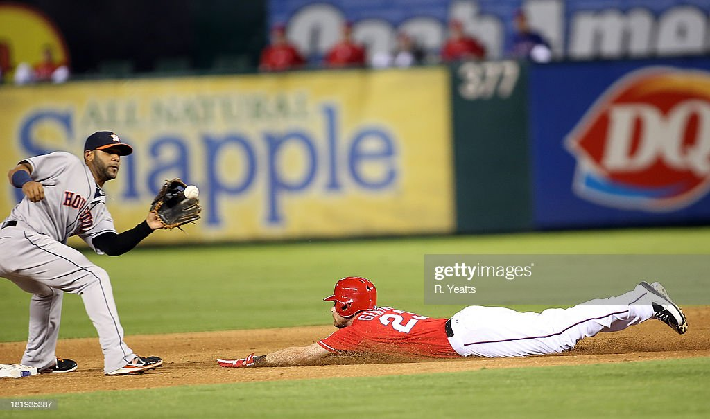 <a gi-track='captionPersonalityLinkClicked' href=/galleries/search?phrase=Craig+Gentry&family=editorial&specificpeople=6352553 ng-click='$event.stopPropagation()'>Craig Gentry</a> #23 of the Texas Rangers steals second base against Jonathan Villar #6 of the Houston Astros at Rangers Ballpark on September 23, 2013 in Arlington, Texas.