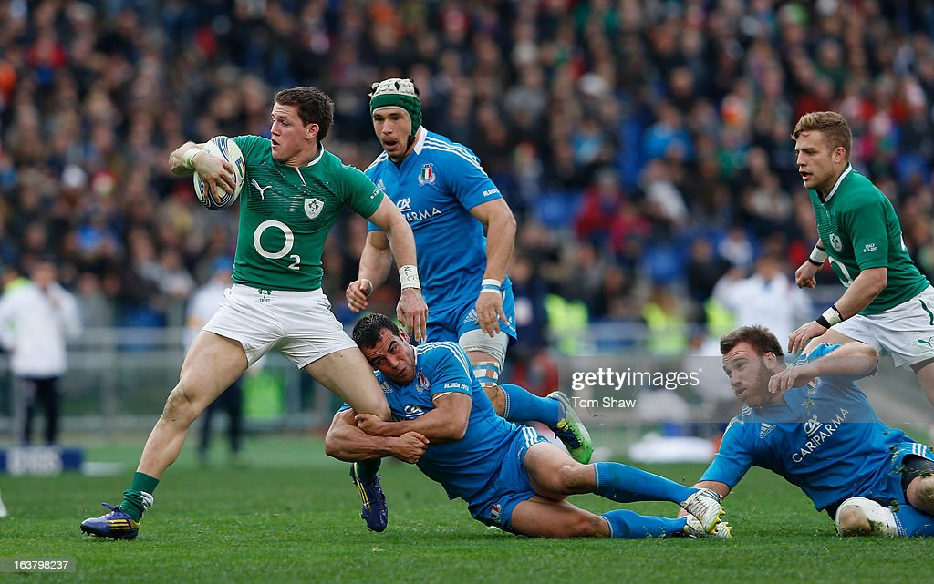 Craig Gilroy of Ireland is tackled during the RBX Six Nations match between Italy and Ireland at Stadio Olimpico on March 16 2013 in Rome Italy