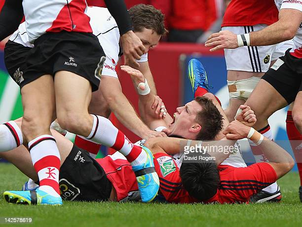 Craig Gilroy of Ulster celebrates after scoring the first try during the Heineken Cup quarter final match between Munster and Ulster at Thomond Park...
