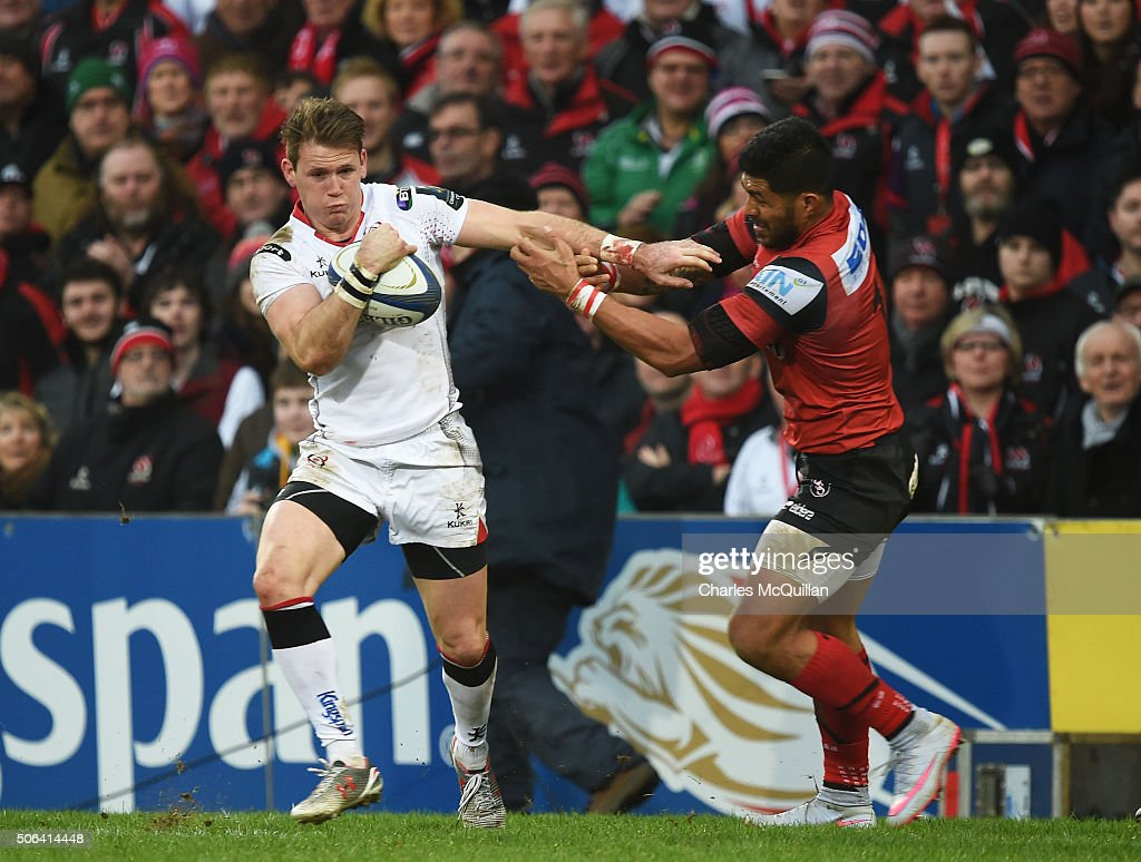 Craig Gilroy of Ulster is tackled by Alaska Taufa of Oyonnax during the European Champions Cup Pool 1 round 6 game between Ulster and Oyonnax at...