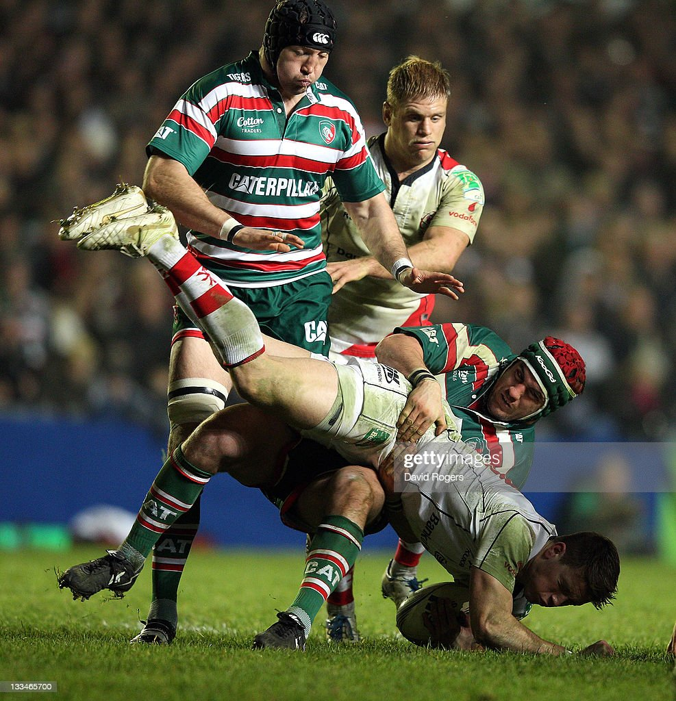 Craig Gilroy of Ulster is tackled by <a gi-track='captionPersonalityLinkClicked' href=/galleries/search?phrase=Marcos+Ayerza&family=editorial&specificpeople=3034035 ng-click='$event.stopPropagation()'>Marcos Ayerza</a> during the Heineken Cup match between Leicester Tigers and Ulster at Welford Road on November 19, 2011 in Leicester, United Kingdom.