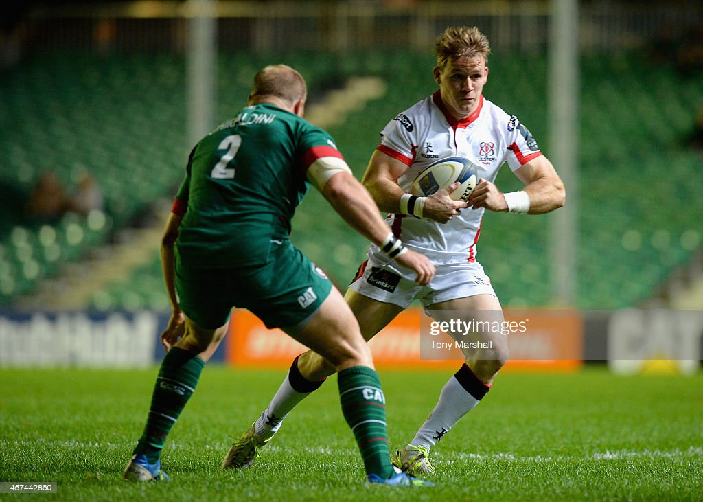 Craig Gilroy of Ulster Rugby looks for a way past Leonardo Ghiraldini during the European Rugby Champions Cup Pool 3 match between Leicester Tigers v...