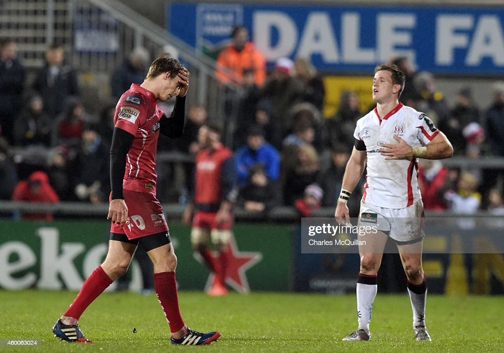 Craig Gilroy of Ulster watches as Liam Williams of Scarlets walks off the pitch after being sent off during the European Rugby Champions Cup match...