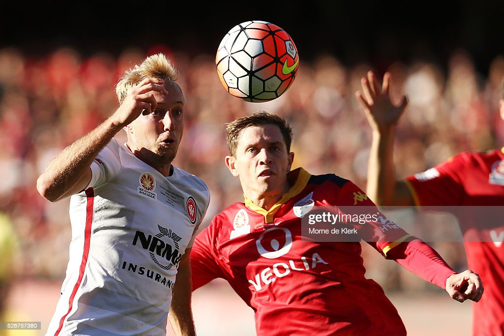 Craig Goodwin of Adelaide United and Mitch Nicolls of the Wanderers competes for the ball during the 2015/16 A-League Grand Final match between Adelaide United and the Western Sydney Wanderers at the Adelaide Oval on May 1, 2016 in Adelaide, Australia.