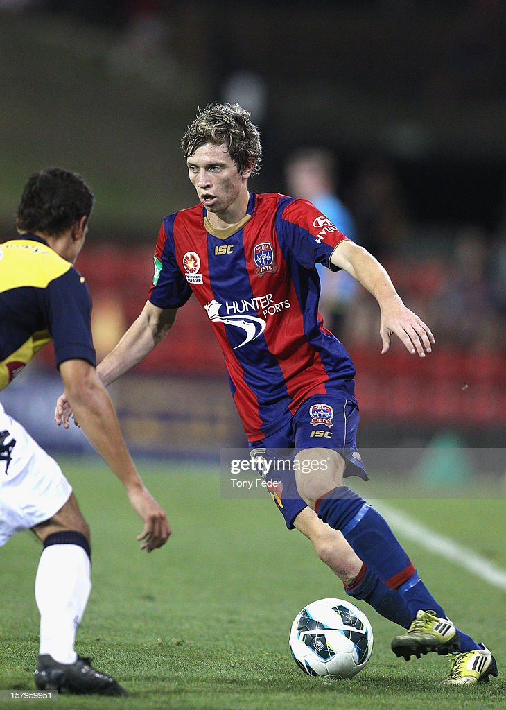 Craig Goodwin of the Jets controls the ball during the round ten A-League match between the Newcastle Jets and the Central Coast Mariners at Hunter Stadium on December 8, 2012 in Newcastle, Australia.