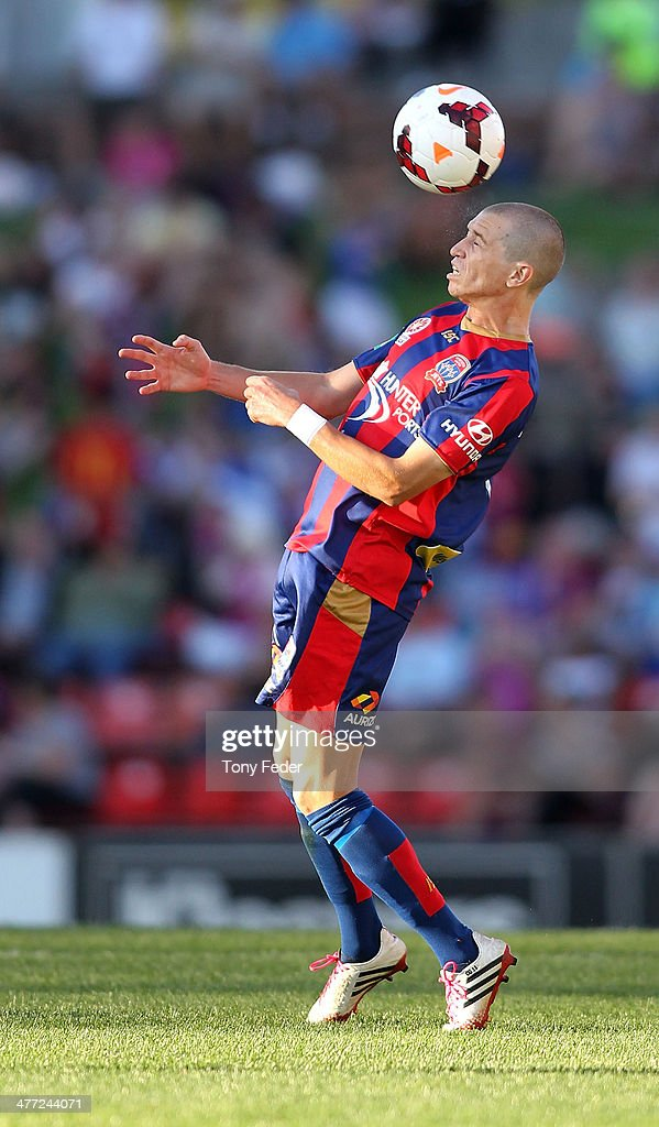Craig Goodwin of the Jets heads the ball during the round 22 A-League match between the Newcastle Jets and Melbourne Heart at Hunter Stadium on March 8, 2014 in Newcastle, Australia.