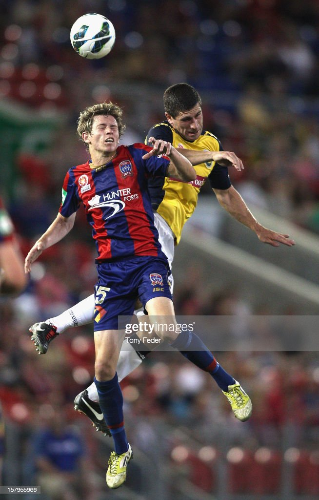 Craig Goodwin of the Jets heads ther ball away during the round ten A-League match between the Newcastle Jets and the Central Coast Mariners at Hunter Stadium on December 8, 2012 in Newcastle, Australia.