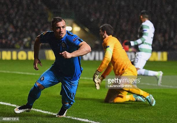 Craig Gordon of Celtic looks dejected as Xherdan Shaqiri of Inter Milan celebrates as he scores their first goal during the UEFA Europa League Round...
