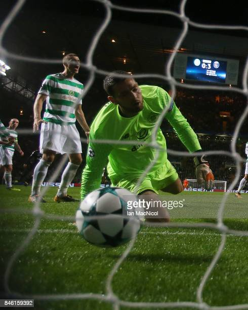 Craig Gordon of Celtic looks on as Mikael Lustig scores an own goal during the UEFA Champions League Group B match Between Celtic and Paris...