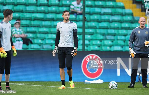Craig Gordon of Celtic looks on in the warm up prior to the UEFA Champions League Playoff First leg match between Celtic and Hapoel BeerSheva at...