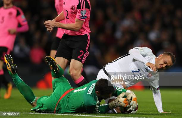 Craig Gordon of Scotland is tackled by Stanislav Lobotka of Slovakia during the FIFA 2018 World Cup Group F Qualifier between Scotland and Slovakia...