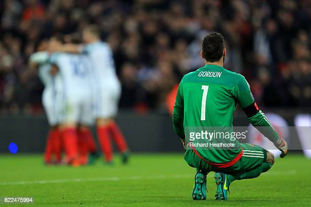 Craig Gordon of Scotland reacts as Adam Lallana of England scores their second goal during the FIFA 2018 World Cup qualifying match between England...
