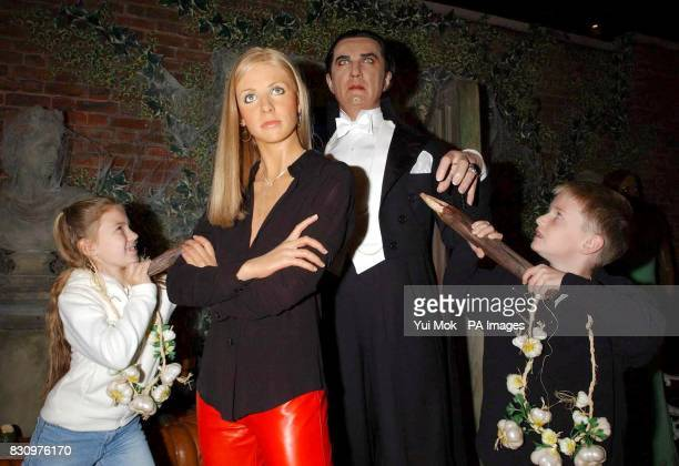 Craig Guthrie aged 9 from Glasgow and Katherine Fletcher aged 10 from Ickenham protect a new waxwork model of Buffy The Vampire Slayer against a...