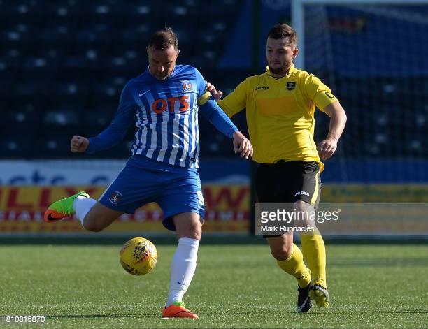 Craig Halkett of Livingston and Kris Boyd of Kilmarnock challenge for the ball during the pre season friendly between Kilmarnock and Livingston at...