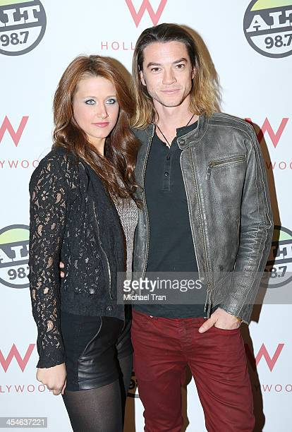 Craig Horner and guest attend The ALTimate Rooftop Christmas party held at W Hollywood on December 9 2013 in Hollywood California