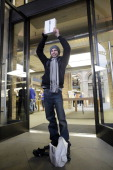 Craig Jobbins first buyer of the new iPad to leave the Apple Store poses for photographers in Covent Garden on March 16 2012 in London England The...
