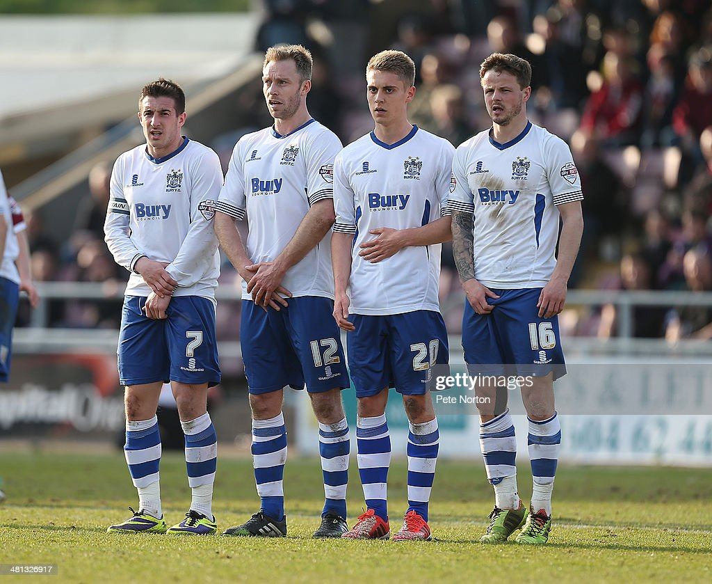 Craig Jones Chris Sedgwick Daniel Rose and Andrew Tutte of Bury form a defencive wall as they defend a free kick during the Sky Bet League Two match...