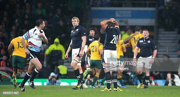 Craig Joubert the referee sprints off the pitch after the final whistle as Scotland are defeated during the 2015 Rugby World Cup Quarter Final match...