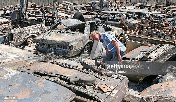 Craig Kidd surveys the damage to vehicles in his backyard after a bushfire went through his property on February 9 2009 in Bendigo Australia Victoria...