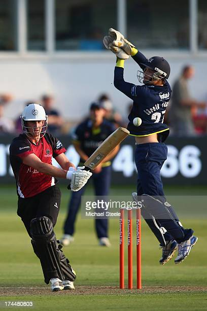 Craig Kieswetter of Somerset Sabres pullss a delivery to the legside as wicketkeeper Gareth Roderick of Gloucestershire Gladiators looks on during...