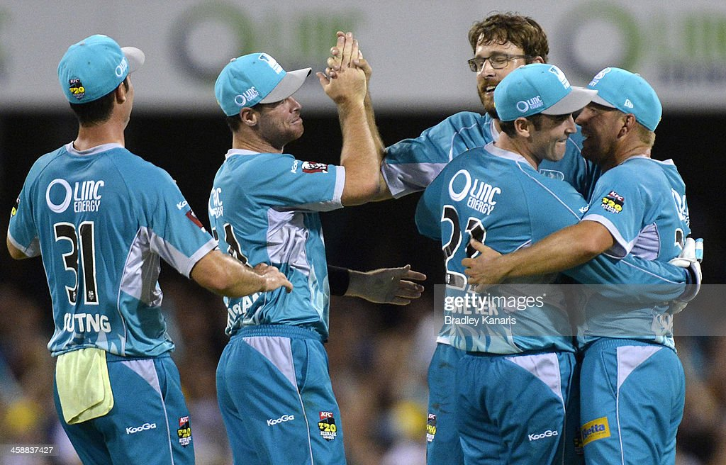 <a gi-track='captionPersonalityLinkClicked' href=/galleries/search?phrase=Craig+Kieswetter&family=editorial&specificpeople=4267430 ng-click='$event.stopPropagation()'>Craig Kieswetter</a> of the Heat celebrates with team mates after stumping Adam Voges of the Scorchers during the Big Bash League match between the Brisbane Heat and the Perth Scorchers at The Gabba on December 22, 2013 in Brisbane, Australia.