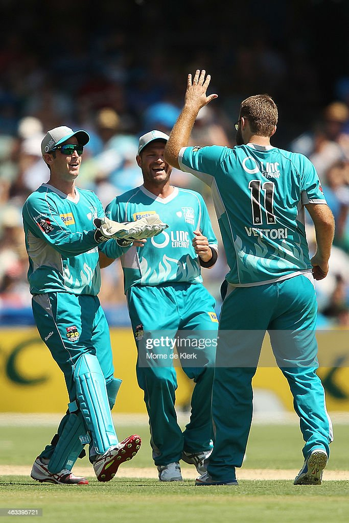 Craig Kieswetter of the Heat celebrates with teammate Daniel Vettori after getting the wicket of Jono Dean of the Strikers during the Big Bash League...