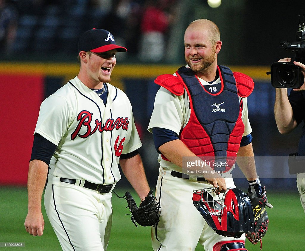 Craig Kimbrel #46 and Brian McCann #16 of the Atlanta Braves celebrate after the game against the Milwaukee Brewers at Turner Field on April 14, 2012 in Atlanta, Georgia.